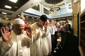 muslims offer their first friday prayers at the new mosque
