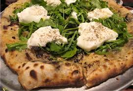 until i tasted the special that night finally someone did a porchetta pizza it came with pickled and sautéed red onions fresh arugula garlic
