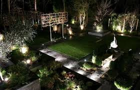 awesome landscape lighting idea feat green lawn and topiaries design plus modern raised garden