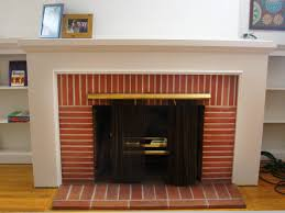 diy fireplace surround with brick fireplace and fireplace screen also fireplace hearths with wood flooring and bookshelves plus picture frames with interior