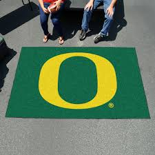 show your team pride in the parking lot with the oregon ducks ulti mat area rug this 5 by 8 foot mat works for tailgates but it also makes a great area