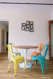 z l construction singapore colourful mismatched dining chairs and photo frames