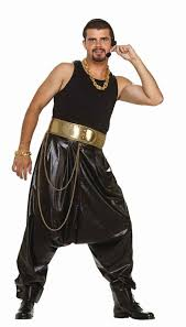 mc hammer s trademark outfit is either a black shell suit or baggy trousers and shirt coupled with black round rim