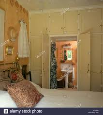 Bedroom with built in storage cupboards over doorway with double ...