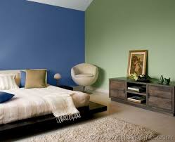 blue coloured walls in this bedroom create a setting that