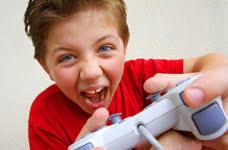 Angry Kid Yells While Playing Video Game - angry-kid-playing-game