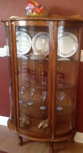 Uranium glass is glass which has had uranium, usually in oxide diuranate form, added to a glass mix before melting. Vintage Curio China Cabinet Half Round With Curved Glass And Original Key At California Favorites 4 U Antique China Cabinets Glass China Cabinet Furniture