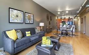 light gray couch dark gray sofa and carpet lamp table gray dining room set geometric rug light toned wooden light grey couch living room
