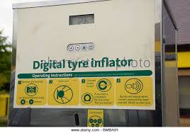 tire inflator gas station. digital tyre inflator at a petrol station - stock image tire gas