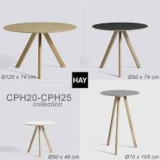 the copenhague round table cph20 and chp25 made in solid wood and plywood by ronan and erwan bouroullec hay