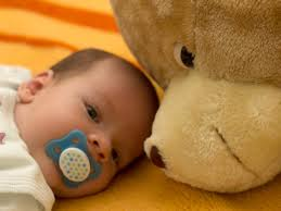 When can my baby sleep with a stuffed animal or doll? | BabyCenter