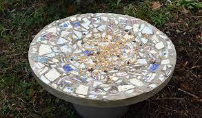 bird table with broken crockery
