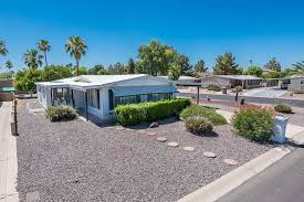 perfect furnished winter home on a corner lot in sun lakes home has a spacious floor plan with additional bonus room and updated master bath