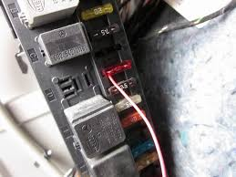 moron s guide to aftermarket head unit installation org i simply wrapped some wire around the metal pin of a 10a fuse and shoved it in the fuse 7 hole