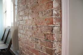 before after exposing a brick chimney under plaster faux painting over brick fireplace chalk paint on