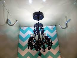 the led chandeliers run on 3 aaa batteries are magnetic to the top of the locker and have a motion sensor i really love this black one it s so cute
