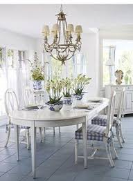 blue and white swedish style dining room interior designer home owner joann barwick photos jessica klewicki traditional home