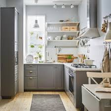 A small sized, traditional-style grey and white kitchen with BODBYN drawer  fronts in