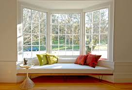 View in gallery Modern window seat with colorful cushions
