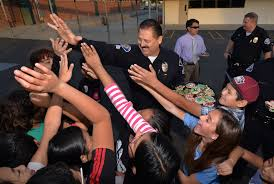 garden grove pd sgt john reynolds gets high fives from post elementary students during a dec 9 visit during which they presented officers with