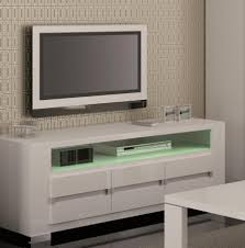 white tv unit with green lighting