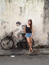 this wall art is the most famous wall art little children on a bicycle located at lebuh armenian  on famous wall art in penang with anerly penang wall street art