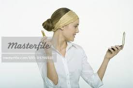 woman holding hand mirror. Teenage Girl Holding Lipstick, Looking At Self In Hand Mirror - Stock Photo Woman