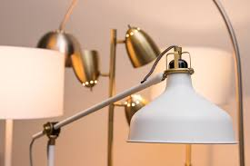 a group of our lamps with a white bell lamp unlit in the front left