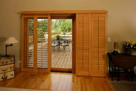 window covering ideas inspiration wood shutter panels on a sliding track