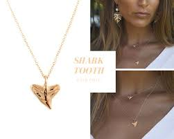 this beautiful rose gold shark tooth necklace is 18 long and can be worn alone or to layered up and create an individual look and style