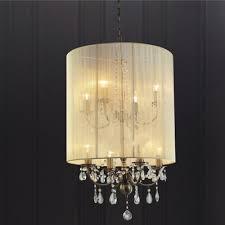 ella 8 light pendant in antique brass and crystal encased in a cream silk string shade diyas il30069