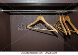 empty closet with hangers. Wooden Hangers Hanging In An Empty Closet On The Upper With 9