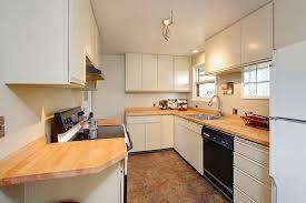 what is the best way to use appliance paint on laminated kitchen cabinets