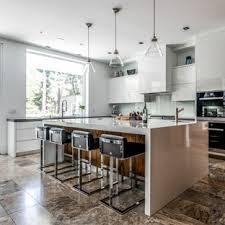 kitchen design white cabinets black appliances. Contemporary Kitchen Designs - Example Of A Trendy L-shaped Brown Floor Design In White Cabinets Black Appliances P