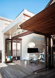 Stylish dining area extends into the backyard Stylish Sydney House Gets A  Sustainable And Energy Efficient