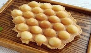 They are usually served hot, and often eaten plain, although they may be served with fruit and flavors such as strawberry, coconut or chocolate.2 it is referred to by its original cantonese name, gai daan jai (雞蛋仔),1 and in english, an egg puff, bubble waffle, eggette, pancake balls, pancake waffle, egglet. Stainless Steel Electric Eggettes Egg Waffle Maker Kitchen Appliance High Quality Egg Waffle Maker Egg Wafflewaffle Maker Aliexpress