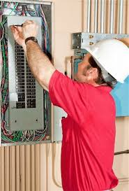 electrician fixing fuse box stock photos page 1 masterfile electrician fixing fuse box licensed master electrician working on an industrial breaker panel stock
