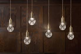 the brushed brass pendant fitting engraved with the lee broom logo creates a clean and simple outline with the clear crystal bulb each pendant fitting