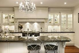 brilliant crystal chandelier over kitchen island chandeliers modern smoke gray sink lighting nice islan