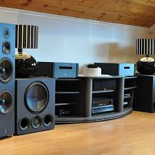 concert speakers system. a finished attic is transformed into concert arena with the addition of dual subwoofers and dali speakers. speakers system y