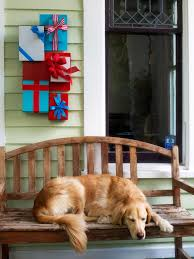 wooden gift box sculpture on porch wall