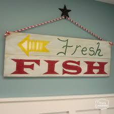 simple diy reclaimed wood sign for the entry hall