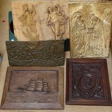 various carved wood wall plaques