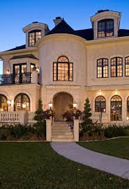 luxury home lighting. Amazing Home With Turret. Cream Colored Exterior Dark Roofing. - Luxury Decor Lighting T