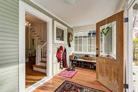 gorgeous wall mount coat rack in entry farmhouse with green siding next to wall mounted shoe rack alongside vestibule and entryway bench