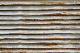 painting rusted corrugated metal rug designs rusty grate with shriveled white paint roofing how iron roof
