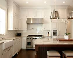 Elegant l-shaped kitchen photo in Atlanta with a farmhouse sink, paneled  appliances,