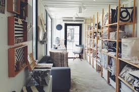 scandinavian home decor with simple wooden cushion rack and nice