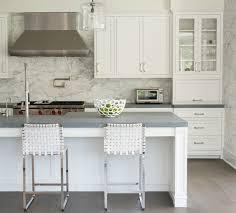 honed granite countertops modern white kitchen white bar stools