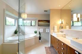 modern master bathrooms master bathroom with glass chandelier above cornered bathtub and modern vanity cabinet contemporary